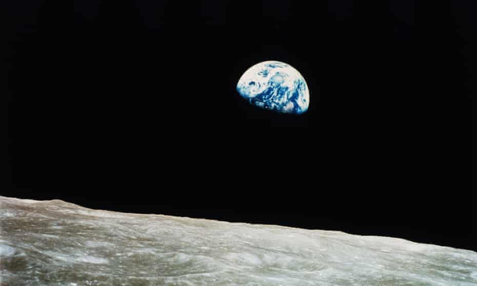 The Earth rises into view over the lunar horizon for the astronauts aboard Apollo 8 in 1968.