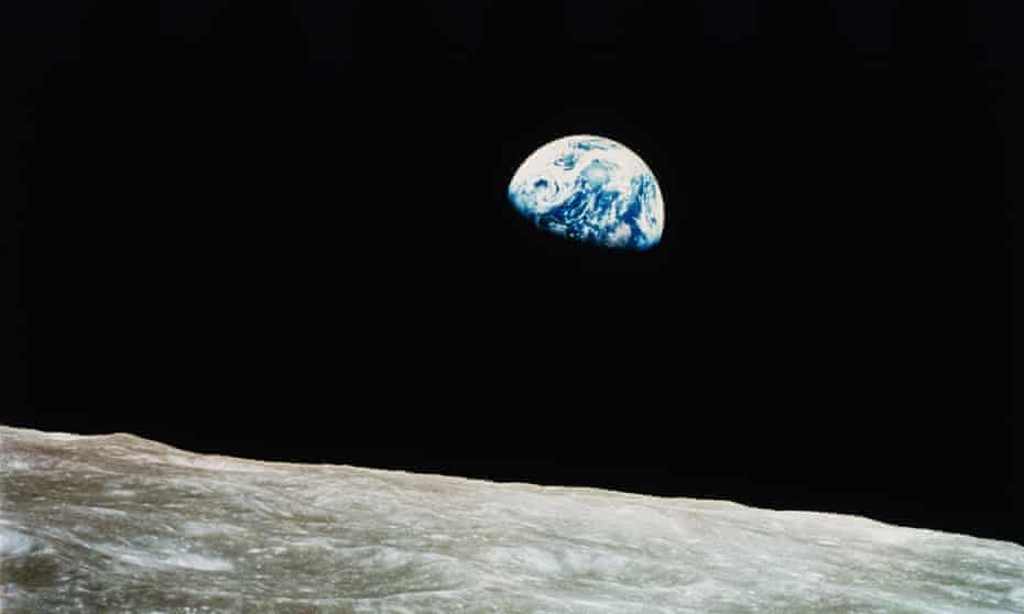 Earth rises over the lunar horizon