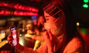 Yuan Qinggai 26, a singer/blogger livestreams from the bar at 44KW, a nightclub iat the Found 158 entertainment precinct in Huangpu district.