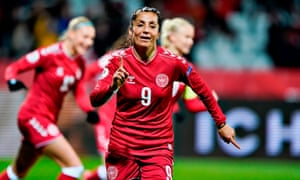 Nadia Nadim celebrates after scoring for Denmark. 'I experience similar emotions or adrenaline rush inside the operating room,' she says.