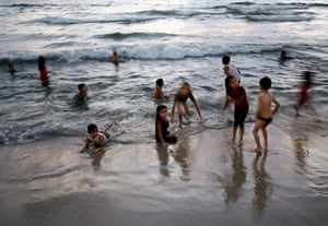Gaza City, GazaPalestinian children play in the water at the beach