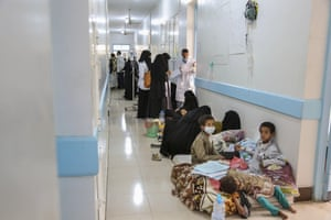 Patients suffering from suspected cholera wait to receive treatment at a hospital in Sana'a