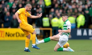 Ryan Christie fouls Livingston's Scott Robinson, leading to a red card for the Celtic player
