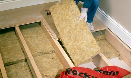 Insulation is installed under the floorboards of a property.