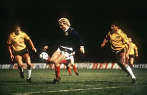 Frank McAvennie gets the close attention of Australia's David Ratcliff, left, and Charlie Yankos.
