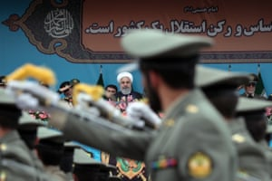 The Iranian president, Hassan Rouhani, attends a military parade held to mark the country's National Army Day