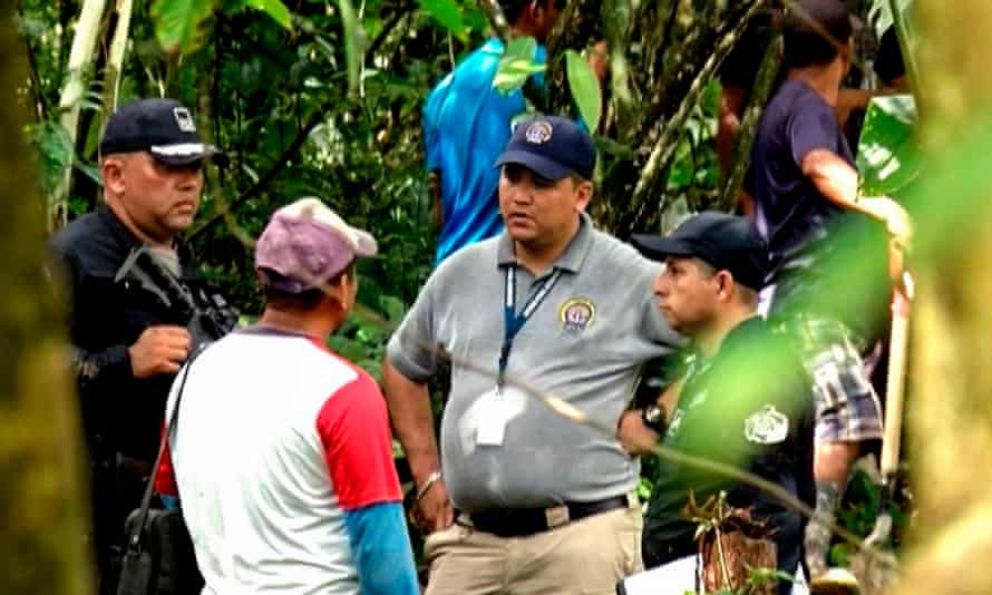 Grab taken from the Panamanian channel TVN Noticias showing police and employees of the public ministry near the site where a mass grave was found with seven bodies at the indigenous region of Ngabé Buglé, in Bocas del Toro province, Panama, on 15 January.