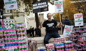 A protester stages a food bank demonstration in Whitehall complete with tons of packaged food.