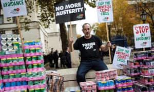 A protester stages a food bank demonstration on Whitehall against universal credit.