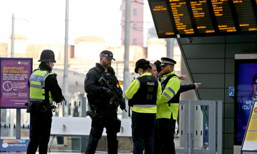 Armed police officers at Manchester Victoria Metrolink station following the stabbing on New Year's Eve