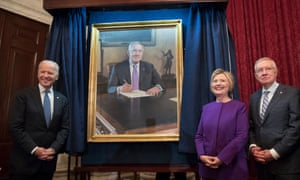 Hillary Clinton stands beside Harry Reid and Vice-President Joe Biden at the unveiling of a portrait of Reid.