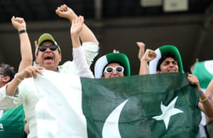 Pakistan fans celebrate as they watch their team score 308.