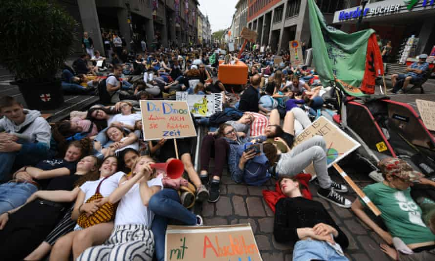 Protesters stage a die-in during a Fridays for Future protest in May 2019 in Freiburg, Baden-Württemberg