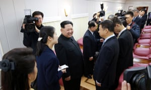 North Korean leader Kim Jong Un with Chinese officials inside the special train on his surprise international debut.
