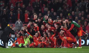 The Wales players celebrate after qualification.