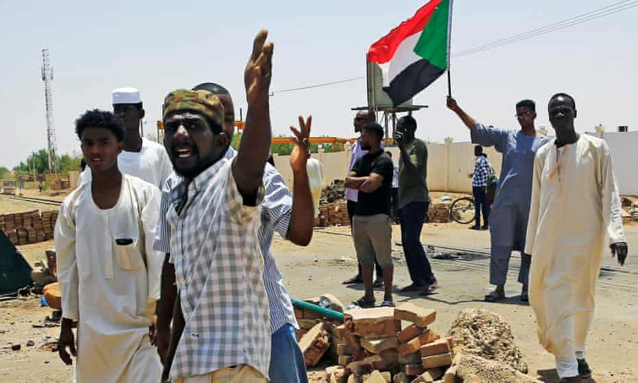 Sudanese protesters in Khartoum set up a barricade on a street, demanding that the country's transitional military council hand over power to civilians