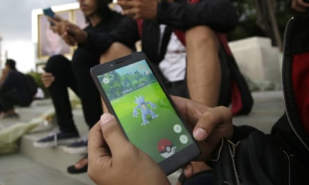 An Indonesian man shows his smartphone as he plays Pokémon Go in Jakarta, Indonesia.