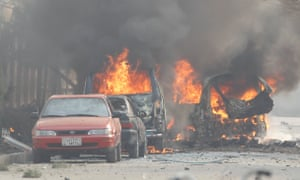 Vehicles on fire after the blast in Jalalabad.