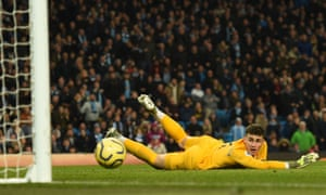 Chelsea's goalkeeper Kepa Arrizabalaga watches as Sterling's shot beats him only to be disallowed after a VAR review.