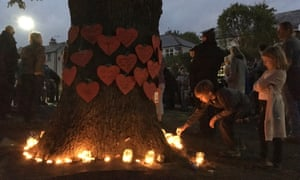 Protesters hold a vigil to save an oak.