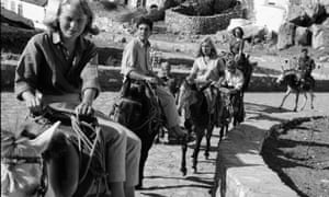 Making tracks: Marianne Ihlen leading Leonard Cohen and friends on donkeys along a stone path in Hydra, in 1950.
