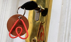 Keychain with the Airbnb logo. The online platform is teaming up with the Transport Workers Union to help get better conditions for delivery drivers.