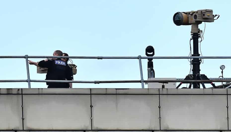 Police officers on a roof at Gatwick on 21 December 2018.