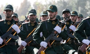 Members of Iran's Revolutionary Guards march during a parade ceremony just outside Tehran.