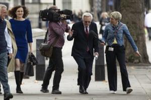 London, UK. Conservative MP David Davis ducks his way past a reporter