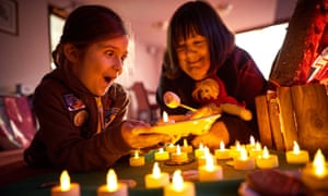 A Brownie spends time with an older person as she works toward her badge launched by Girlguides in Manchester to tackle loneliness in older people