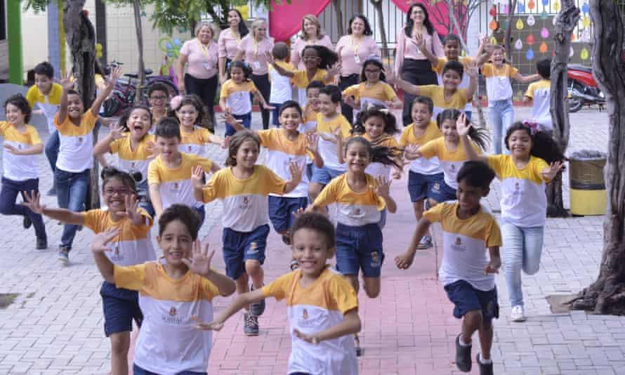 Happy schoolchildren running in Sobral