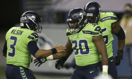 Russell Wilson and Carlos Hyde celebrate a second-half touchdown for the Seahawks