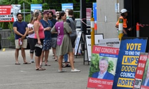 Voters line up at the Coorparoo, Brisbane, pre-polling booth on Wednesday.