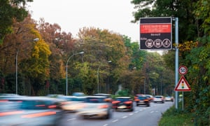 Germany, Stuttgart, Warning sign for particulate pollution on highway