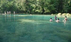 Tourists swimming at one of the pools at Semuc Champey.