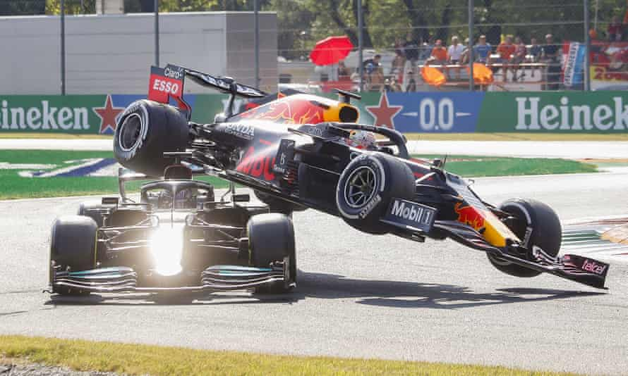Max Verstappen's car (right) flies into the air after colliding with Lewis Hamilton.