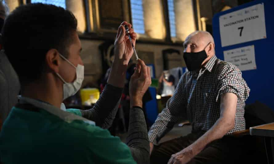 A doctor administers the Pfizer/BioNTech jab at a vaccination centre in Salisbury Cathedral, Wiltshire