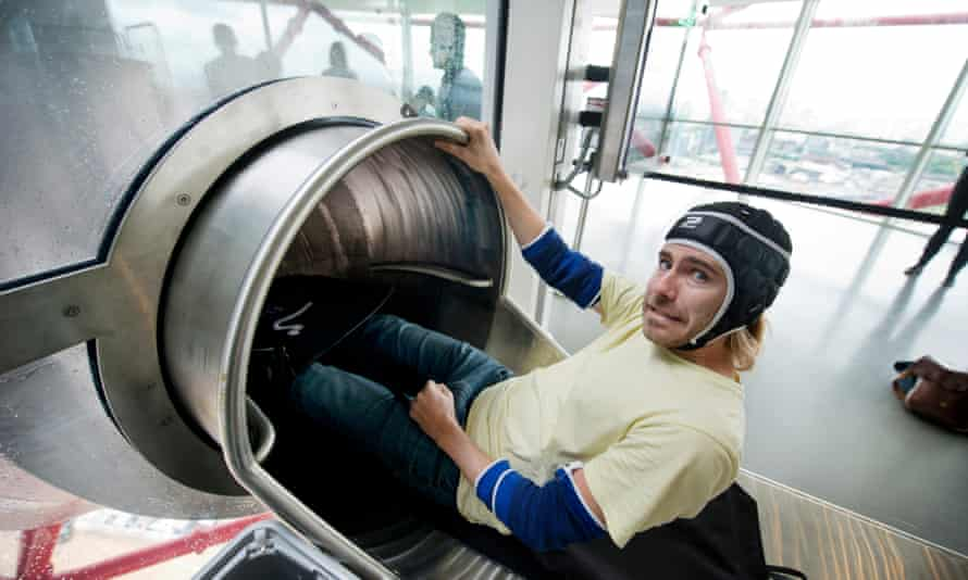 Oliver Wainwright prepares to plunge 76m in 40 seconds down Carsten Höller's slide at the ArcelorMittal Orbit.