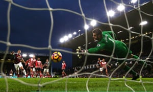Joey Barton of Burnley scores his sides first goal past Fraser Forster of Southampton.