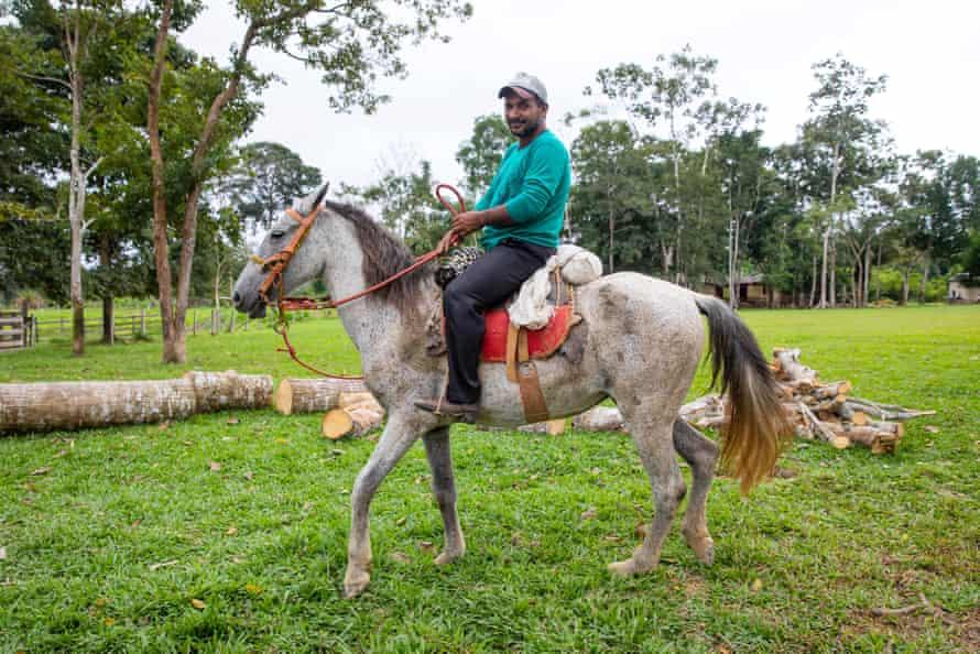 A local seringueiro on horseback.