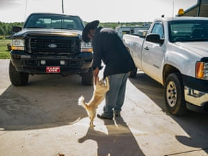 John Boyd Jr pets his dog, Fatso, who he's had since he was a pudgy puppy. He calls Fatso his best friend.