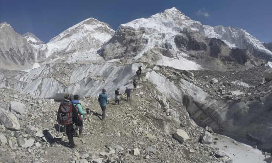 Trekkers pass through a glacier at the Mount Everest base camp in Nepal.