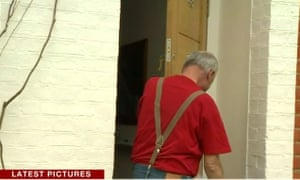 Ken Livingstone removing the flag from his front door