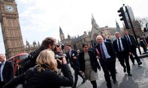 Boris Johnson, seen here in 2017, walks by the parliamentary clocktower housing Big Ben. It is currently undergoing restoration work.
