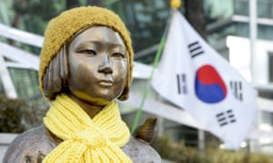 A statue of a girl that represents the sexual victims by the Japanese military in front of Japanese embassy in Seoul, South Korea