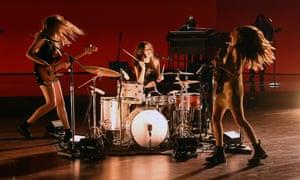 Este Haim, Daneille Haim, and Alana Haim of HAIM performing