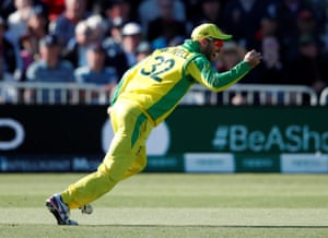Australia's Glenn Maxwell celebrates taking the catch to dismiss West Indies' Andre Russell.