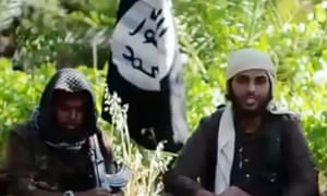 An image from a YouTube video showing Islamist fighters, who claim to be British, appearing in a recruitment video for Isis.