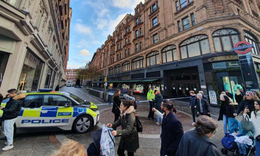 police car and cordoned off street alongside Harrods in SW London