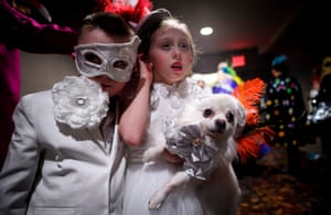 Two children wait backstage with their costumed pooch